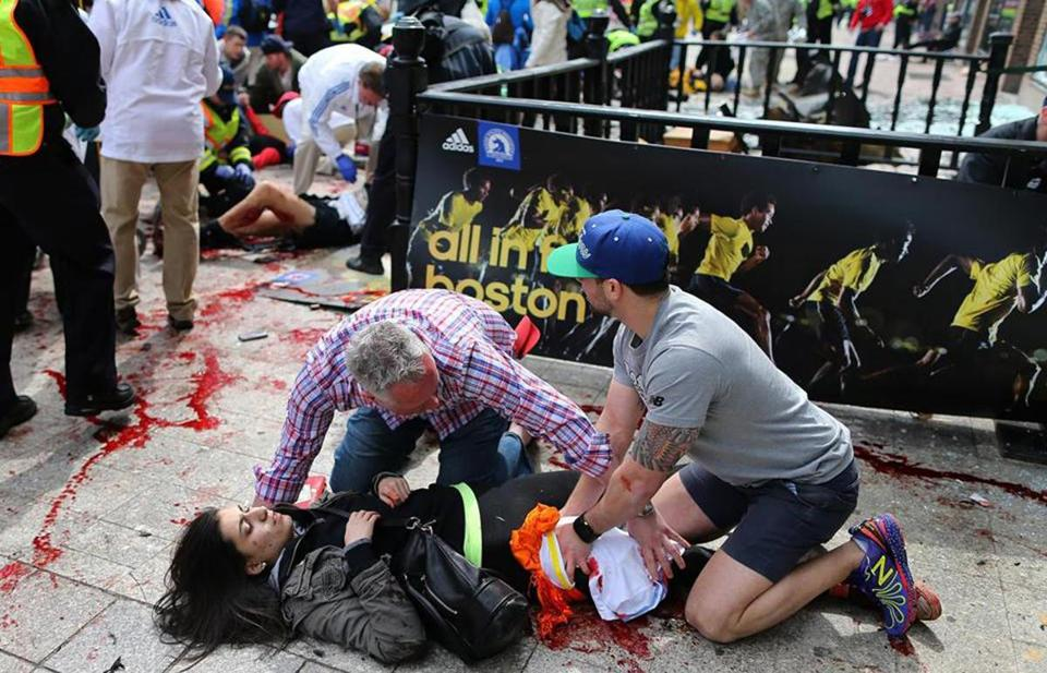 Hero at Boston Marathon bombing who looks to be applying an improvised pressure dressing ...